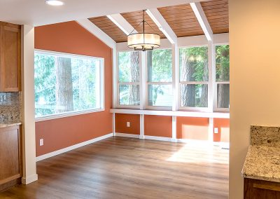 Project feature: Expanded kitchen pulls light from sunroom through living, dining spaces