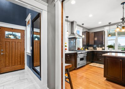 From the marble entryway, take a left into the gorgeous new kitchen, with dark wood cabinets and plenty of natural light.